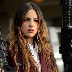 "Darling (Eiza Gonzalez) gets in a gun fight in ""Baby Driver."""
