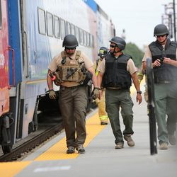 """Emergency personnel look for """"victims"""" during """"Hell on Wheels,"""" a full-scale, two-day, emergency protection and response drill at the Salt Lake Central Station on Tuesday, Aug. 8, 2017. The drill included emergency personnel from the Utah Transit Authority, the FBI, Salt Lake County Emergency Management, the West Valley and Salt Lake City fire departments, University of Utah Emergency Management, the University of Utah Police Department, Amtrak, Union Pacific, Murray Victim Advocates and Utah State Medical Examiner's Office. The drill simulated multiple terrorists entering the Salt Lake Valley and dividing up."""