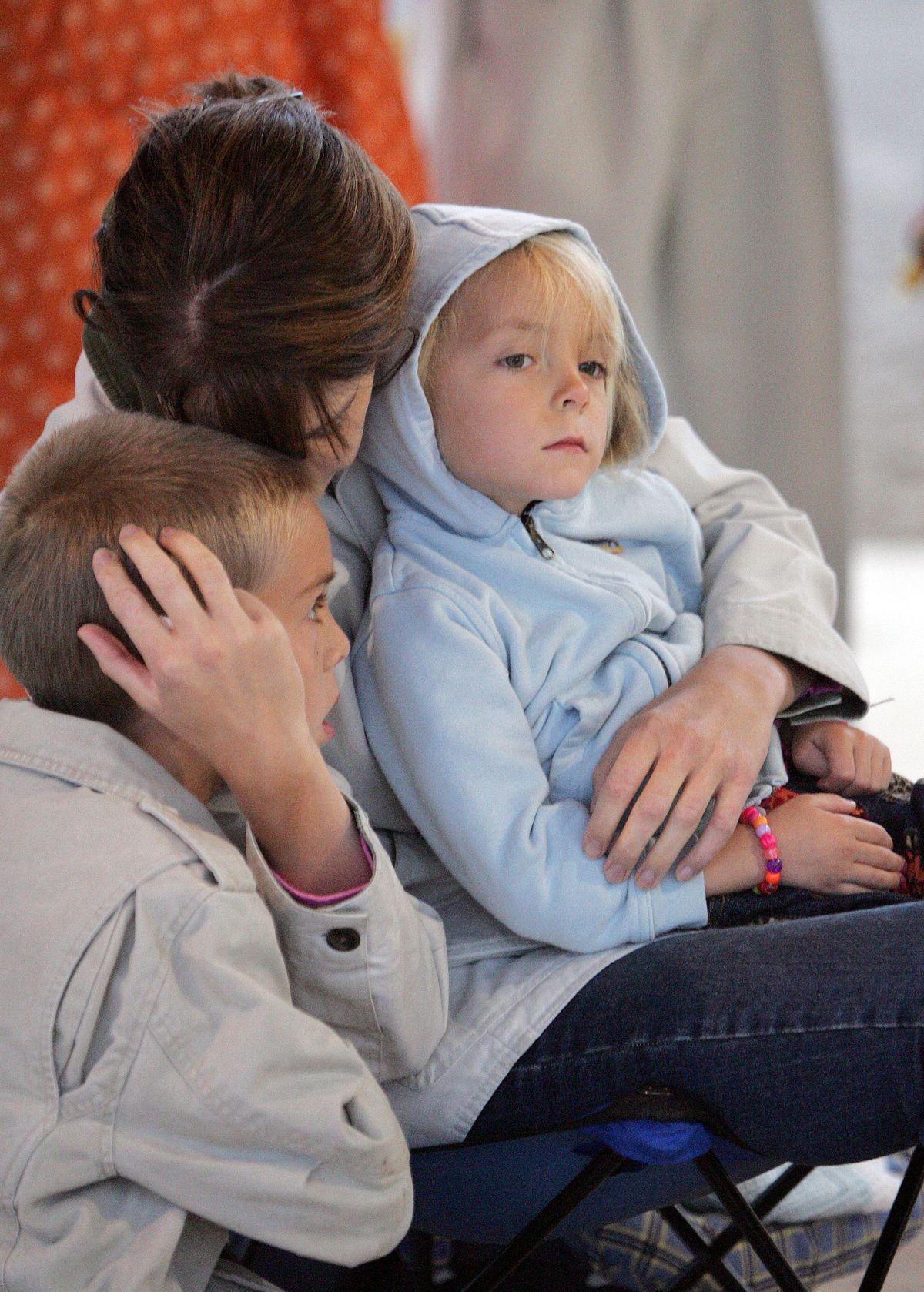 Camille Mortensen holds her children during a 9/11 service in 2005.