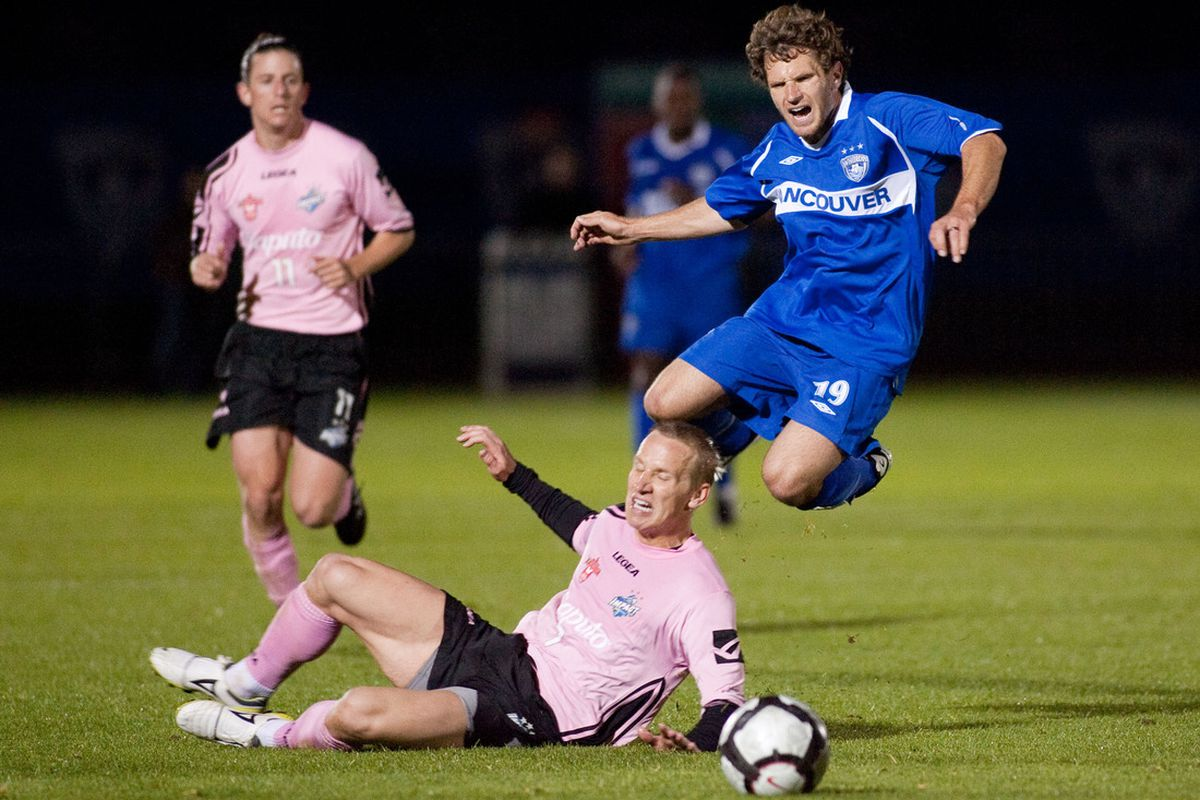 David Testo of the Montreal Impact ducks a jumping Justin Moose in 2010 Voyageurs Cup action. (Bob Frid/Canadian Soccer Association)