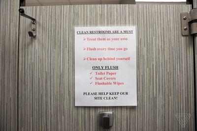 Signage inside a stall of the women's bathroom at Cognizant in Tampa, FL.