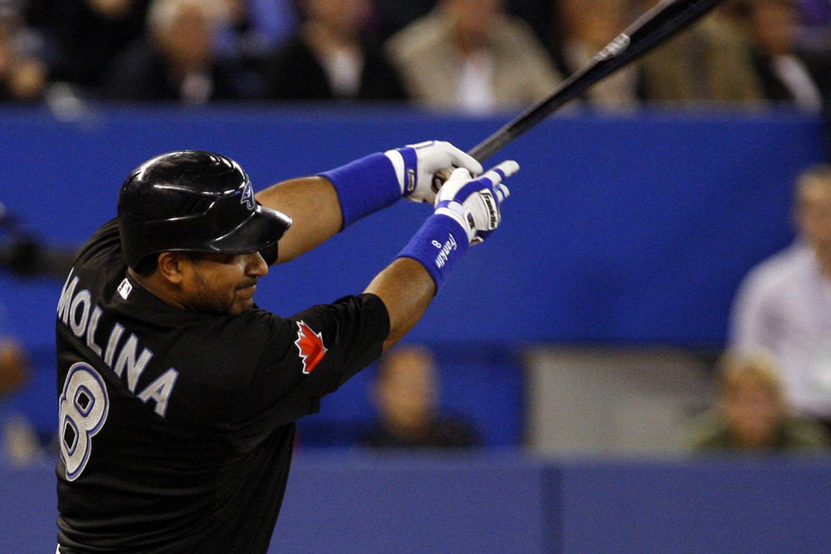 TORONTO, CANADA - SEPTEMBER 16: Jose Molina #8 of the Toronto Blue Jays hits the winning RBI against the New York Yankees during MLB action at the Rogers Centre September 16, 2011 in Toronto, Ontario, Canada. (Photo by Abelimages/Getty Images)