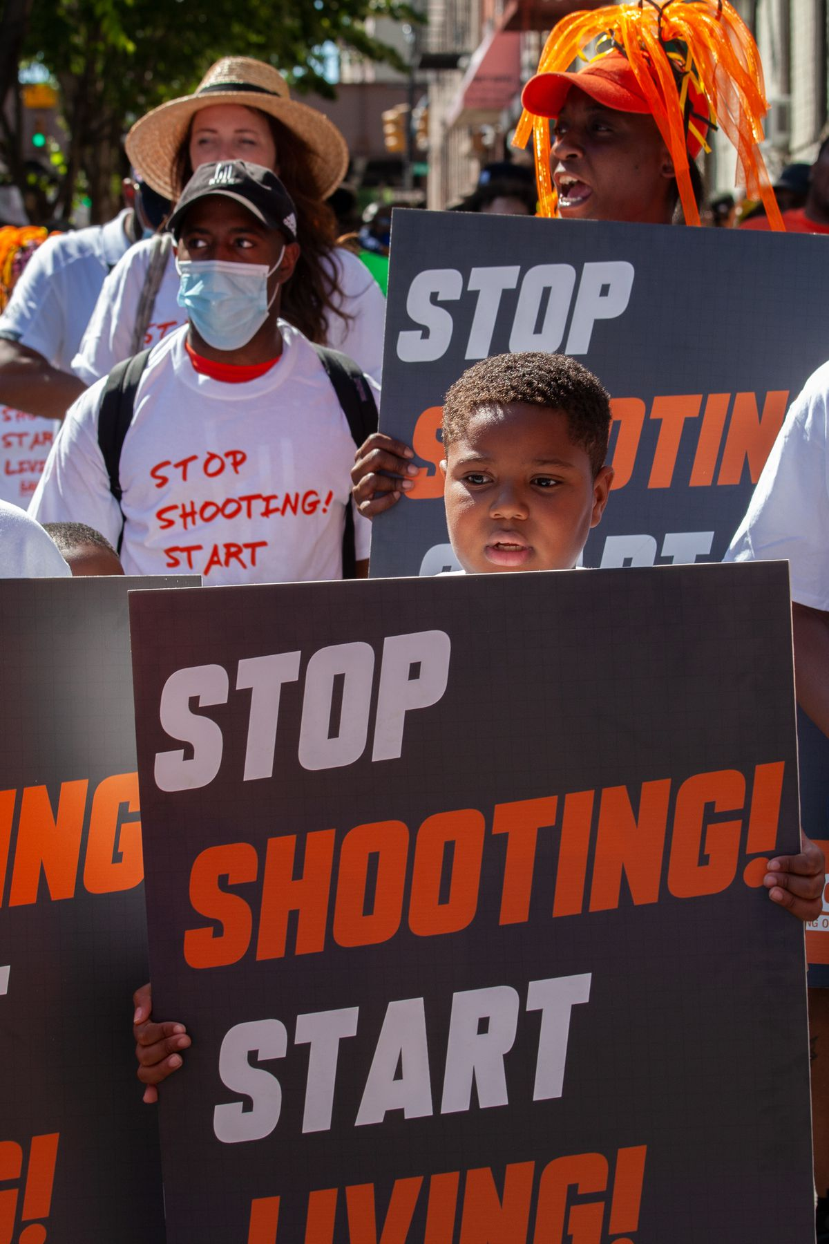 Dozens of anti-violence advocates marched through East Harlem during a surge in shootings, June 17, 2021.