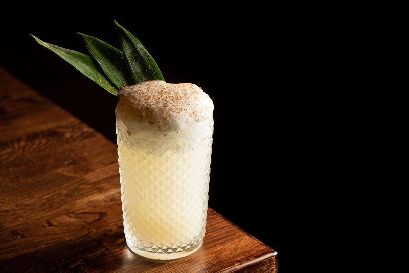 mixtape cocktail foam leaf tall glass table
