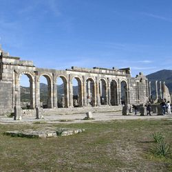 In this Thursday, March 8, 2012 photo, tourists gather around the arches of the Basilica, the main administrative building of Volubilis, Morocco's most famous Roman ruin near Meknes, Morocco.