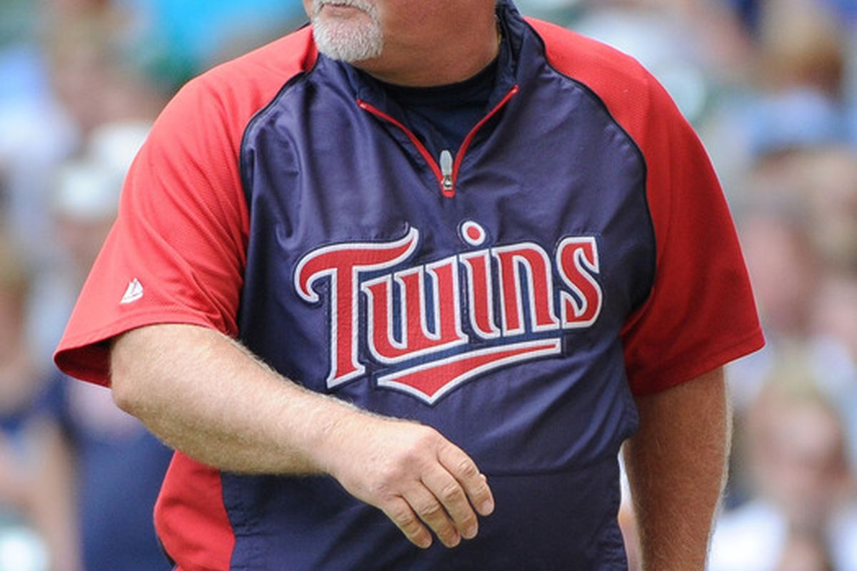 May 20, 2012; Milwaukee, WI, USA;  Minnesota Twins manager Ron Gardenhire makes a pitching change during the game against the Milwaukee Brewers at Miller Park.  Mandatory Credit: Benny Sieu-US PRESSWIRE