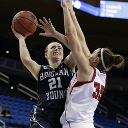 BYU's Lexi Eaton (21) goes up for a basket against Nebraska's Jordan Hooper (35) during the first half of a second-round game in the NCAA women's college basketball tournament on Monday, March 24, 2014, in Los Angeles. (AP Photo/Jae C. Hong)