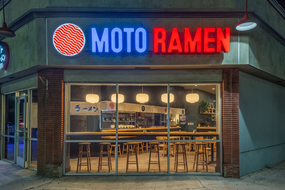 Exterior of Moto Ramen restaurant with bright red and blue signage in Culver City