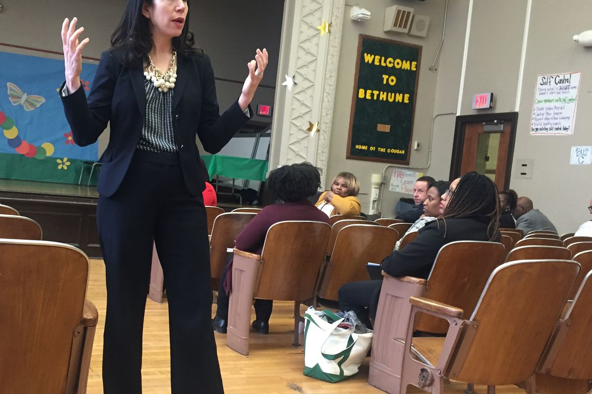 Interim Superintendent Alycia Meriweather addresses parents and teachers at Bethune Elementary-Middle School on Detroit's west side about the school's return to the district.