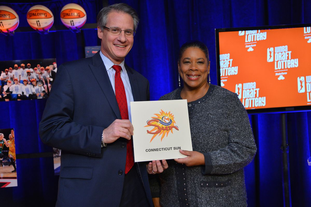 Mohegan Sun CEO Mitchell Etess and WNBA President Laurel Richie pose for a photo after the Connecticut Sun won the first pick in the 2014 Draft.