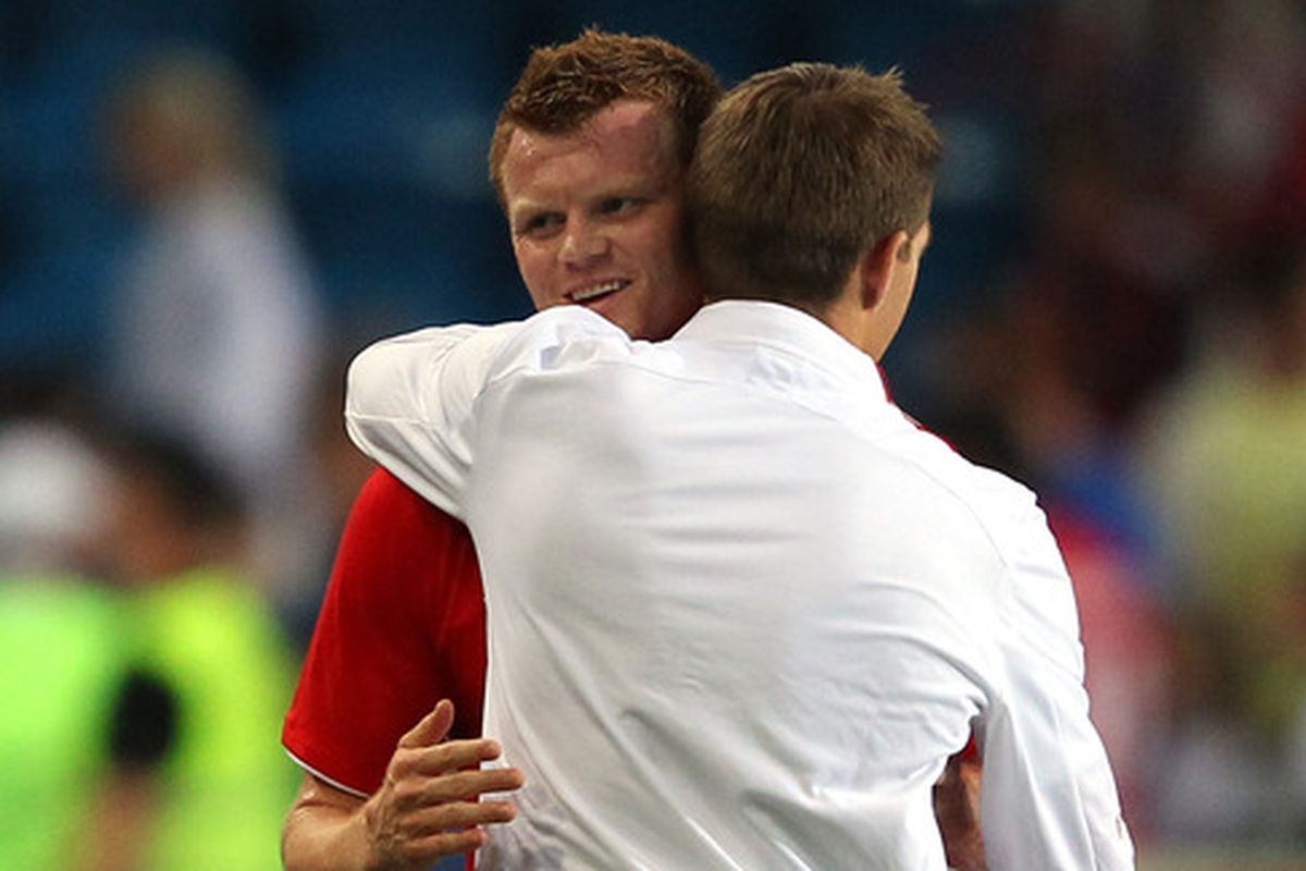 Stevie and Riise, hugging it out.