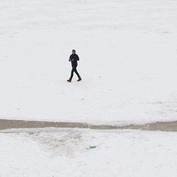 A student walks across the snowy campus of Texas Christian University on Wednesday, Feb. 2, 2011, in Fort Worth, Texas.