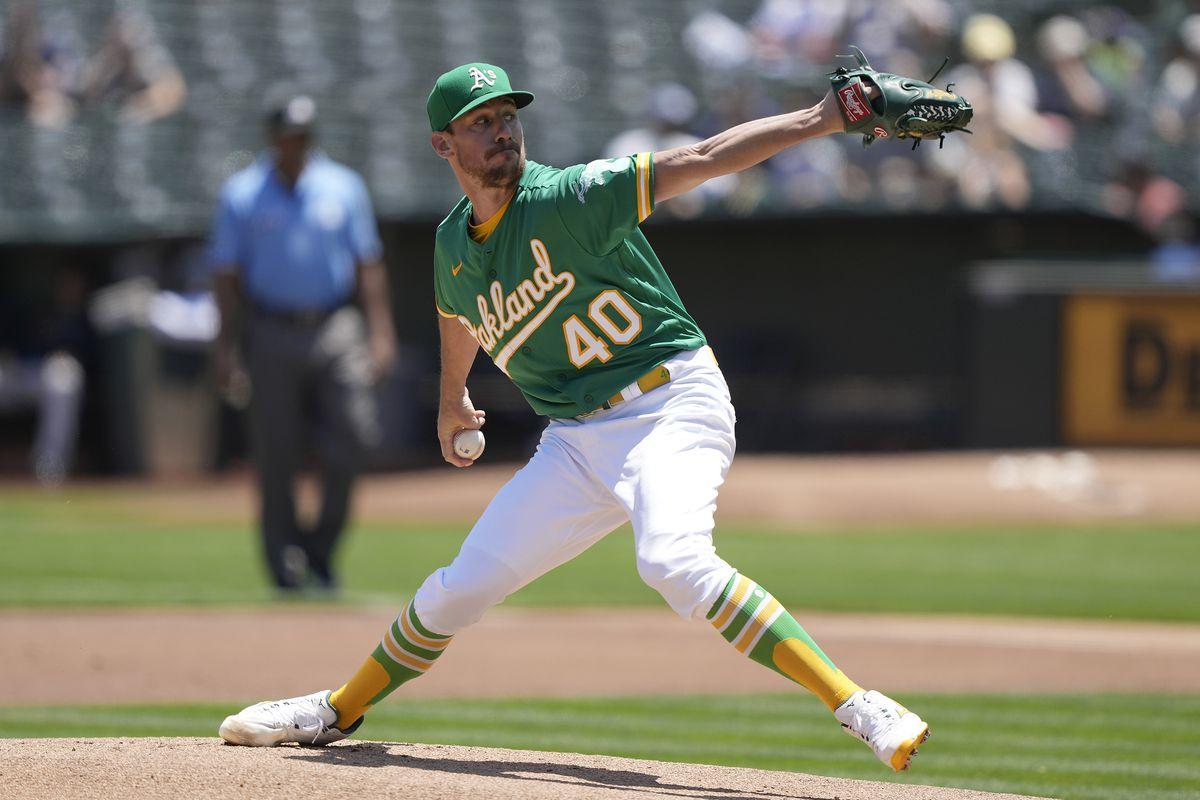 Chris Bassitt #40 of the Oakland Athletics pitches against the Cleveland Indians in the top of the first inning at RingCentral Coliseum on July 18, 2021 in Oakland, California.