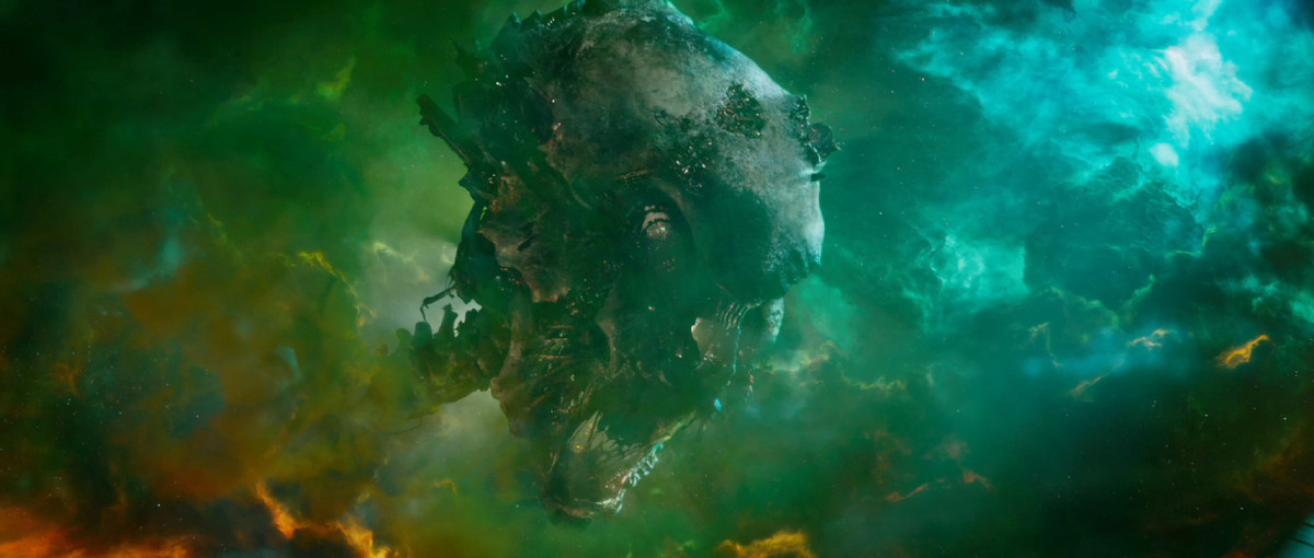 A huge skull and a bit of spinal column float in a stellar nebula, lit by the dwellings of hundreds of alien people in Guardians of the Galaxy Vol. 1