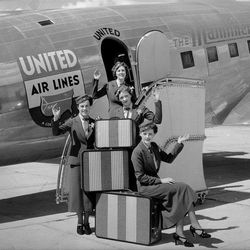 In the 1930's and 40's air travel was something you got dress up for. These United Air Lines stewardess welcome passengers, remember when there was no fee for your luggage.