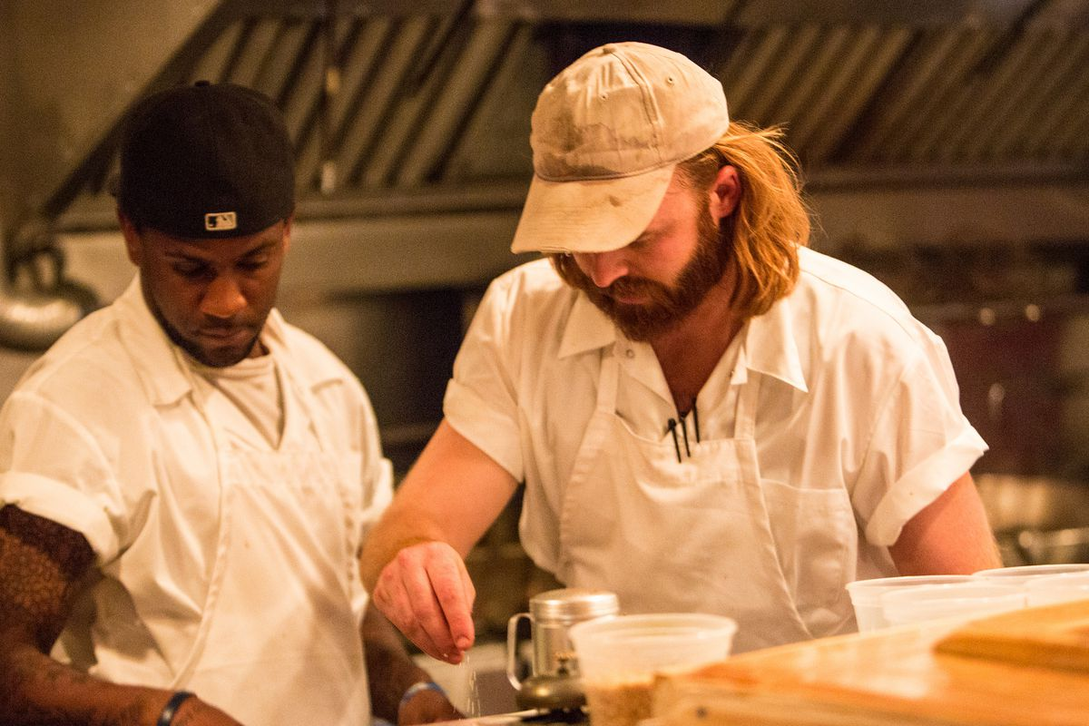 Tobias Womack (on right) in the kitchen at Red's Chinese