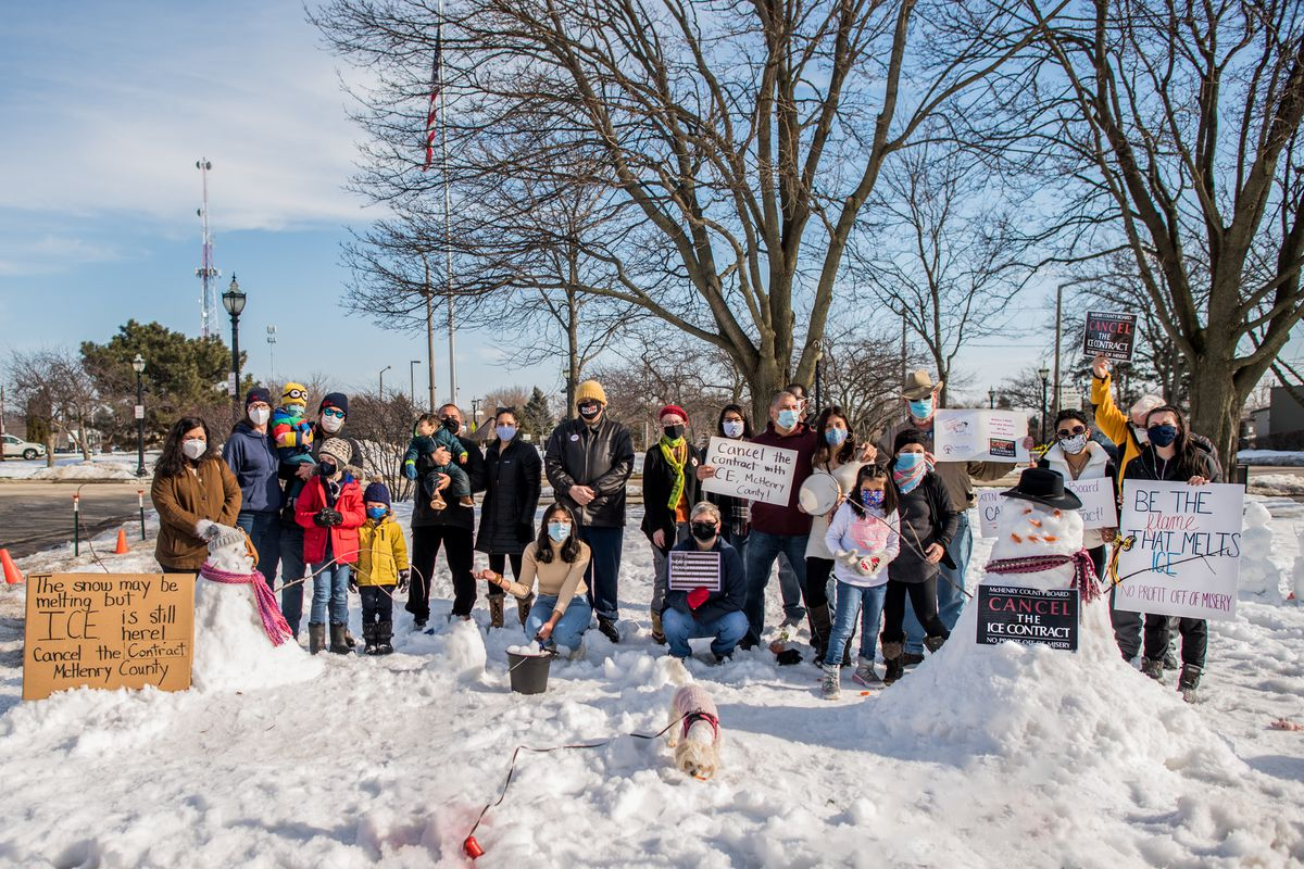 Members of a coalition calling for the end of a contract that allows the McHenry County Jail to detain those in immigration custody held an event Feb. 27, 2021 in Crystal Lake to draw attention to the contract.