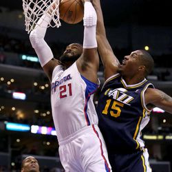 LOS ANGELES, CA - DECEMBER 30: Derrick Favors #15 of the Utah Jazz blocks a shot by Ronny Turiaf #21 of Los Angeles Clippers at Staples Center on December 30, 2012 in Los Angeles, California.   NOTE TO USER: User expressly acknowledges and agrees that, by downloading and or using this photograph, User is consenting to the terms and conditions of the Getty Images License Agreement.  (Photo by Stephen Dunn/Getty Images)