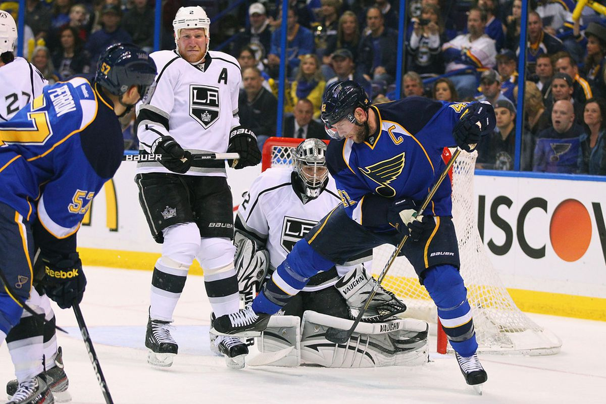 Dunno what Matt Greene is doing with his face here, exactly. (Photo by Dilip Vishwanat/Getty Images)