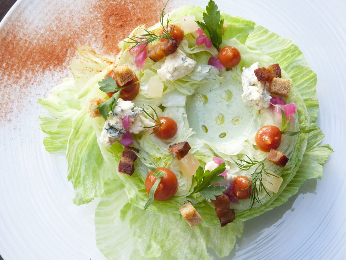 A white plate holds a ring-shaped salad