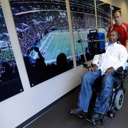 O.J. Brigance, left, former NFL linebacker and current director of player development for the Baltimore Ravens, is assisted through a hallway by his nurse William Shields at the Ravens' practice facility in Owings Mills, Md., Sept. 5, 2012. Brigance was diagnosed in 2007 with amyotrophic lateral sclerosis, or ALS, also known as Lou Gehrig's disease. The manner in which he's fought ALS has been inspirational to the Ravens, notably linebacker Ray Lewis.