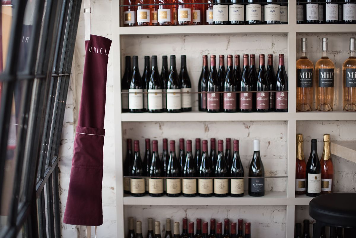 Shelves filled with bottles of red wine.