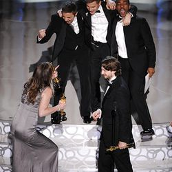"""In foreground, Kathry Bigelow and Mark Boal celebrate with cast of """"The Hurt Locker"""" as they accept the Oscar for best motion picture of the year at the 82nd Academy Awards on Sunday."""