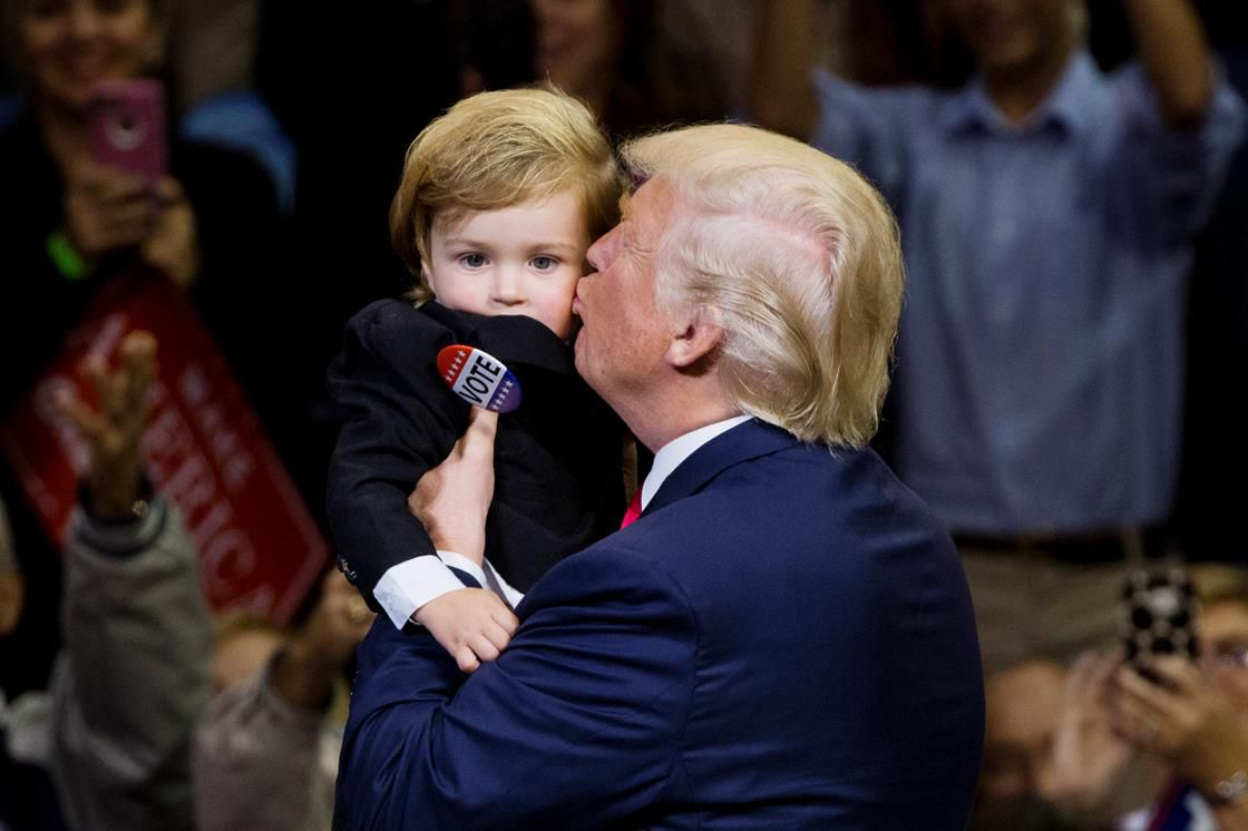 Trump kissing a small child, poor kid