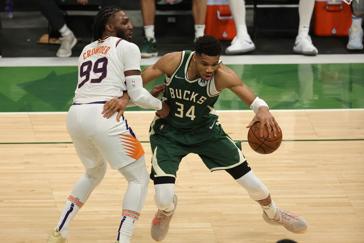 Giannis Antetokounmpo drives to the basket against Jae Crowder in Game 3 of the NBA Finals on Sunday in Milwaukee.
