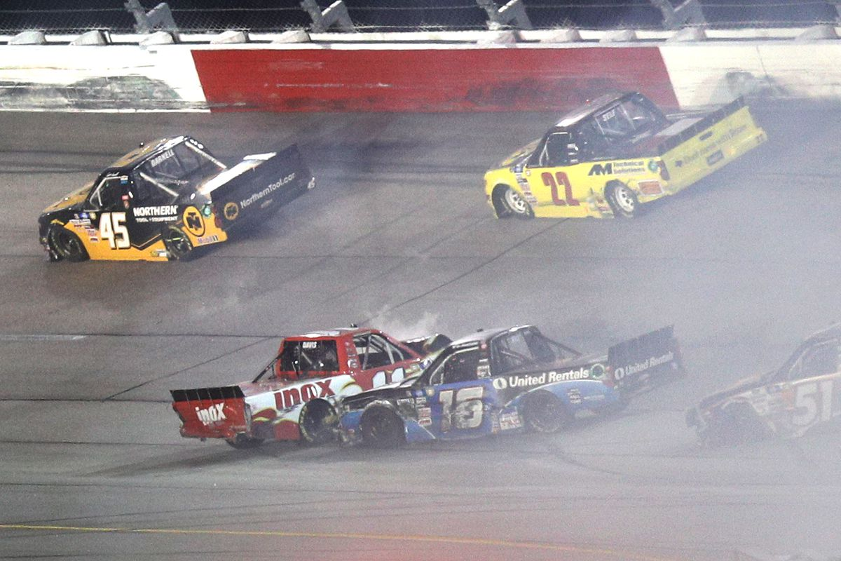 Austin Hill, driver of the #16 United Rentals Toyota, and Spencer Davis, driver of the #11 Inox Supreme Lubricants Toyota, spin after an on-track incident during the NASCAR Camping World Truck Series LiftKits4Less.com 200 at Darlington Raceway on May 07, 2021 in Darlington, South Carolina.