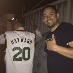 Ghanaian Dennis Agyekum, an Abomosu coach, teacher and sports director, shows off the Gordon Hayward jersey he received after Zach Harding suggested Jazz fans donate outdated apparel instead of burning it.