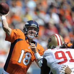 FILE - In this Aug. 26, 2012, file photo, Denver Broncos quarterback Peyton Manning (18) passes against the San Francisco 49ers during the first quarter of an NFL preseason football game in Denver. No need to ask Steelers coach Mike Tomlin if Peyton Manning is back. As far as Tomlin is concerned, the Broncos quarterback never left.