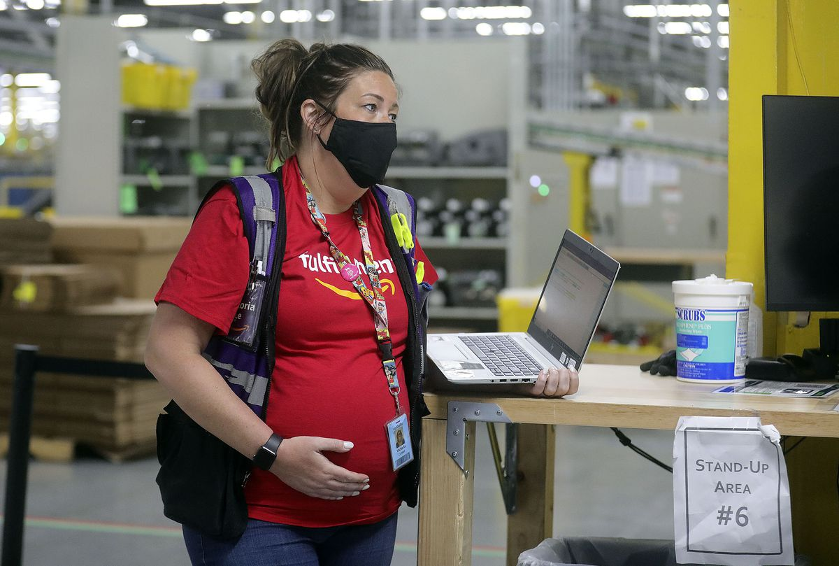 Victoria Le, Amazon assistant general manager, works at the Amazon Fulfillment Center in Salt Lake City on Friday, May 7, 2021.