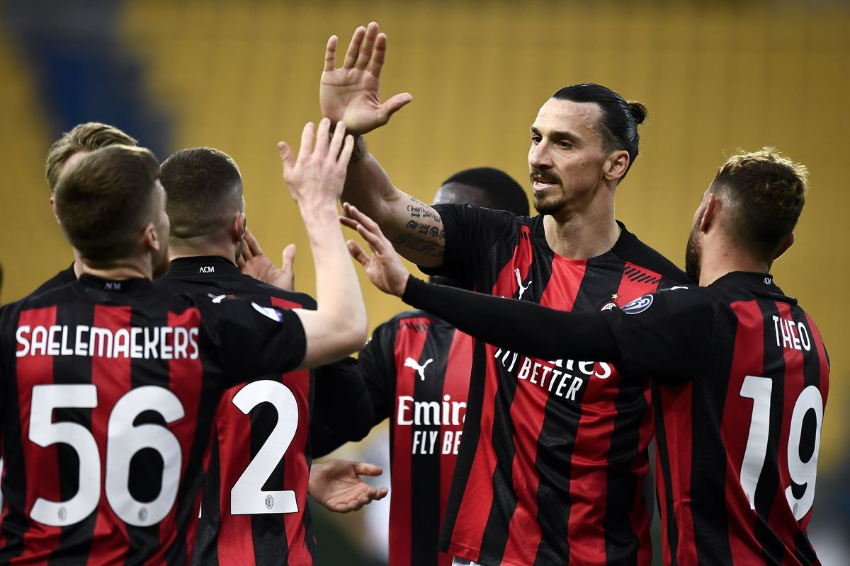 Players of AC Milan celebrate during the Serie A football...