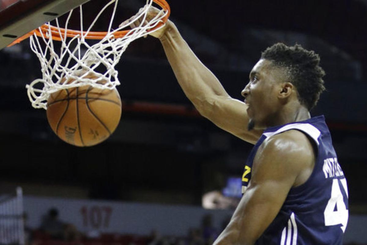 Utah Jazz's Donovan Mitchell dunks against the Memphis Grizzlies during the second half of an NBA summer league basketball game, Tuesday, July 11, 2017, in Las Vegas.