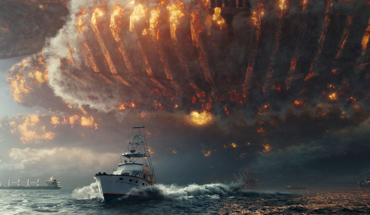"""An alien craft wreaks havoc in the skies above a fleeing ship in """"Independence Day: Resurgence.""""   20th Century Fox"""