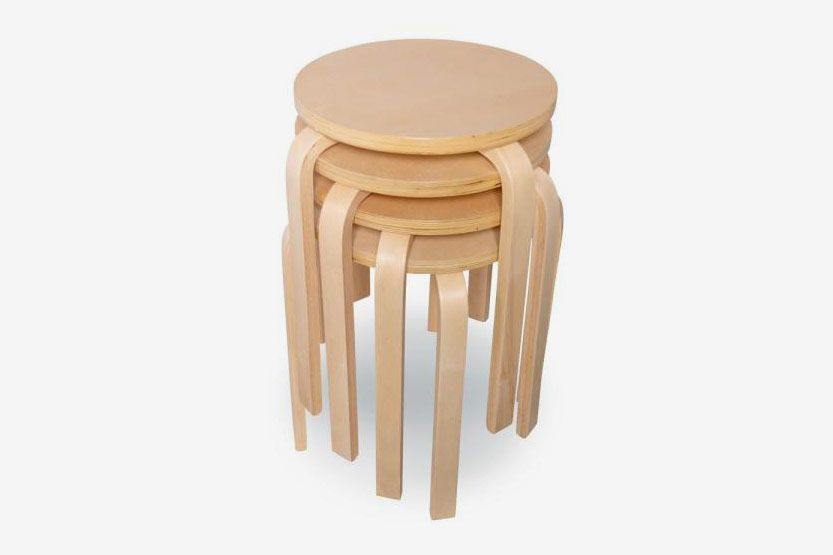 Pale wood chairs stacked on top of each other.