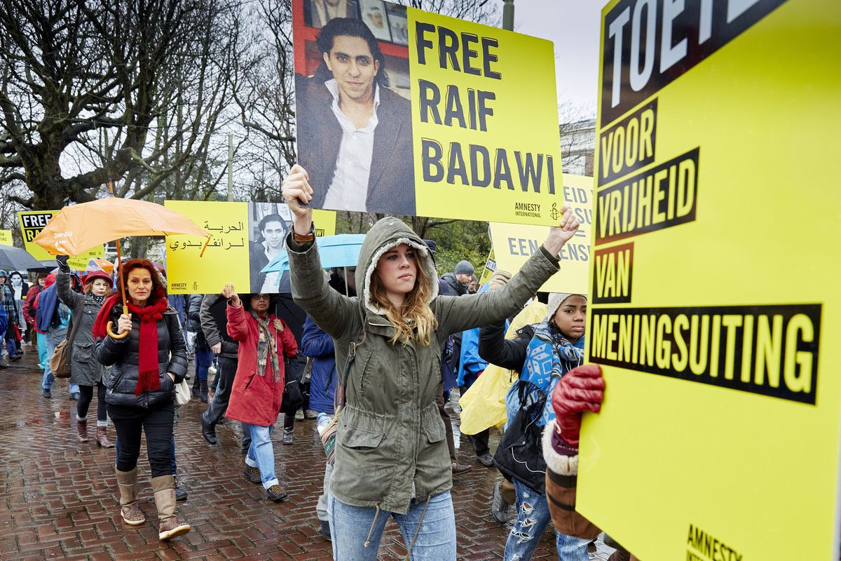 People protest at the Hague against Raif Badawi's 1000 lash sentence for speaking his mind in Saudi Arabia.