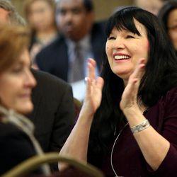 Andalin Bachman applauds during Interfaith Roundtable's annual Interfaith Prayer Breakfast at the Hellenic Cultural Center in Salt Lake City on Thursday, Feb. 5, 2015.