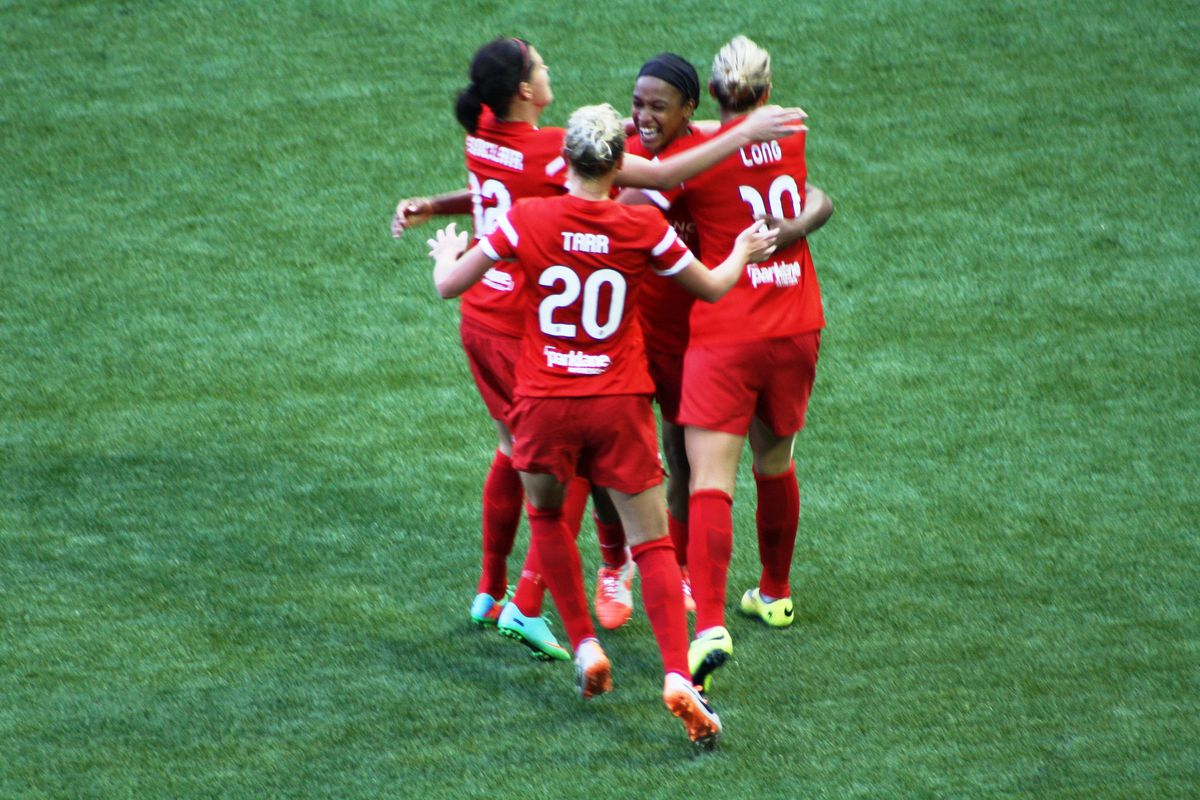 Thorns forward Jessica McDonald (back) celebrates her 2nd half goal.