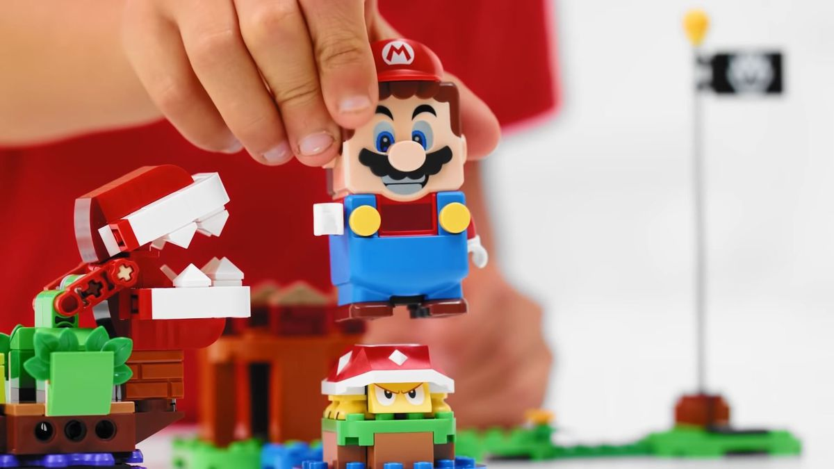 Lego Mario jumps on a turtle.