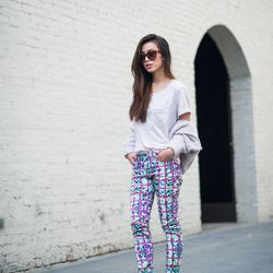 """Jenny of <a href=""""http://www.neonblush.com""""target=""""_blank"""">Neon Blush</a> is wearing <a href=""""http://www.lyst.com/clothing/mary-katrantzou-jeans-foli-rose-pink/?ctx=665379""""target=""""_blank"""">Mary Katrantzou</a> pants, an H&M jacket and shirt, <a href=""""http:/"""
