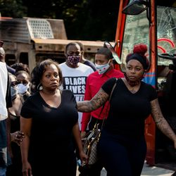 Julia Jackson, Jacob Blake's mom, walks to her car after a press conference Tuesday afternoon, Aug. 25, 2020. Police shot Blake at least seven times in the back Sunday as he was breaking up a fight in Kenosha, according to his attorneys.
