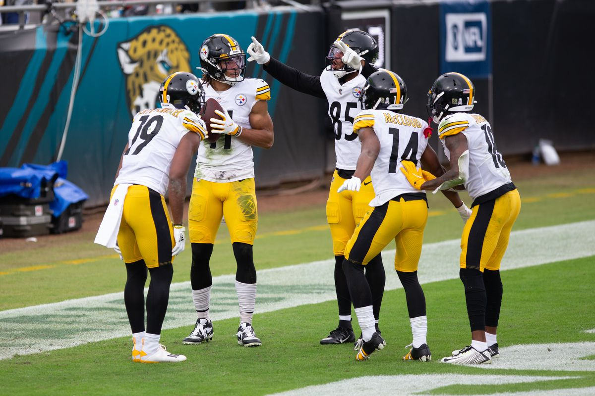 Pittsburgh Steelers Wide Receiver Chase Claypool (11) celebrates a touchdown with Pittsburgh Steelers Wide Receiver JuJu Smith-Schuster (19), Pittsburgh Steelers Tight End Eric Ebron (85), Pittsburgh Steelers Wide Receiver Ray-Ray McCloud (14), and Pittsburgh Steelers Wide Receiver Diontae Johnson (18) during the game between the Pittsburgh Steelers and the Jacksonville Jaguars on November 22, 2020 at TIAA Bank Field in Jacksonville, Fl.