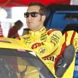FILE- This Aug. 3, 2012 file photo shows Sam Hornish Jr. climbing into his race car during practice for the NASCAR Sprint Cup Series Pennsylvania 400 auto race at Pocono Raceway in Long Pond, Pa. Penske Racing says it is trying to put together a Sprint Cup Series schedule for Hornish next season.