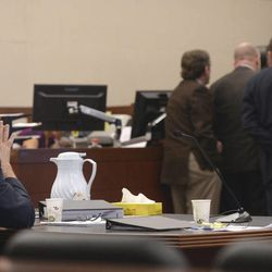 Douglas Anderson Lovell sits by himself at the defense table as Judge Michael D. DiReda calls lawyers to his bench during closing arguments in Ogden, on Tuesday, March 31, 2015.