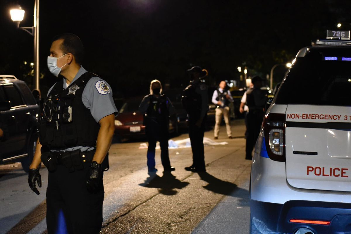 Chicago police investigate after a man was found shot to death Sept. 12, 2020, in West Englewood.