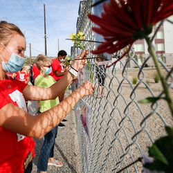 Students from the University of Utah display photographs at the Say Their Names Memorial in Salt Lake City on Saturday, Sept. 26, 2020.