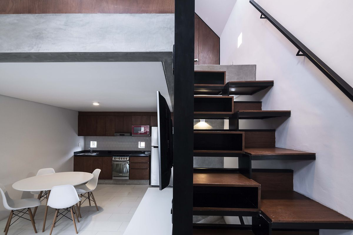 the built ins also conceal additional storageincluding beneath the treads of the stairs the master bedroom is on a lofted mezzanine level above the