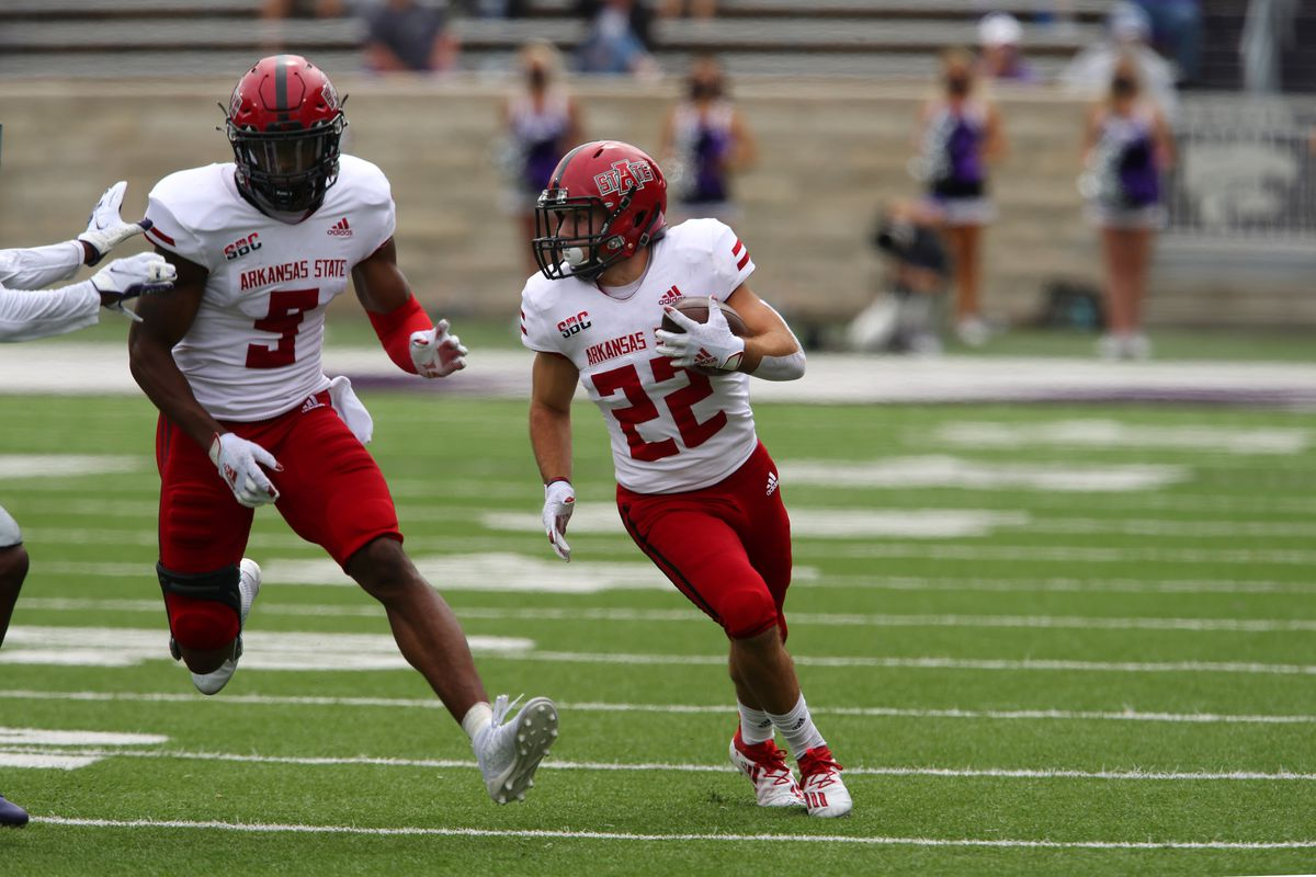 Arkansas State Red Wolves running back Lincoln Pare follows the block of wide receiver Jonathan Adams Jr. during a game against the Kansas State Wildcats at Bill Snyder Family Football Stadium.
